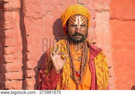 Kathmandu, Nepal : October-18-2018 : Portrait Of Young Sadhu (yogi Or Holy Man) Greeting To Tourist