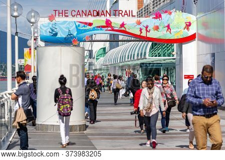 Vancouver, British Columbia / Canada - 06/13/2015. People Enjoying The Surroundings At Canada Place,