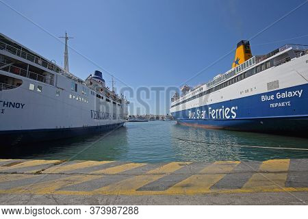 Piraeus, Greece - May 04, 2015: Ships And Ferryboats Moored In Biggest Greek Commercial Port In Pira