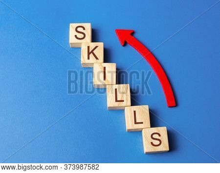 Wooden Blocks With The Word Skills And Up Arrow. Knowledge And Skill. Self Improvement. Education Co