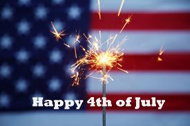 4th of July. A Golden Sparkler burns with an American Flag background. American Pride.  Happy 4th of July text.