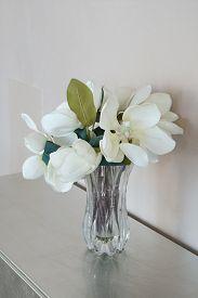 Artificial Magnolia Grandiflora In Vase On The Table