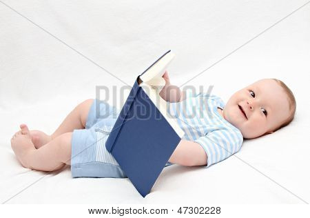 Baby Reading A Book On Back