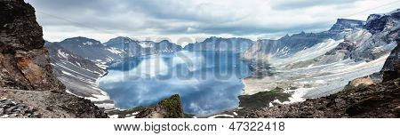 Volcanic rocky mountains and lake Tianchi, wild landscape, national park Changbaishan, China