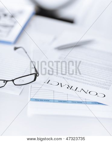picture of signed contract paper with glasses poster