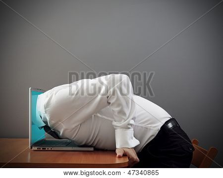 concept photo of internet addiction. man plunging into computer