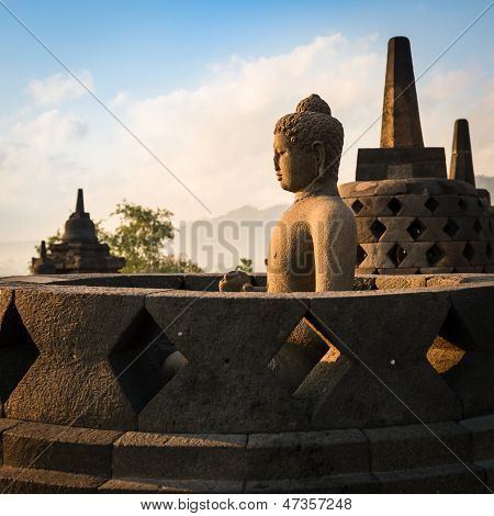 Buddha In Borobudur Temple At Sunrise. Indonesia.