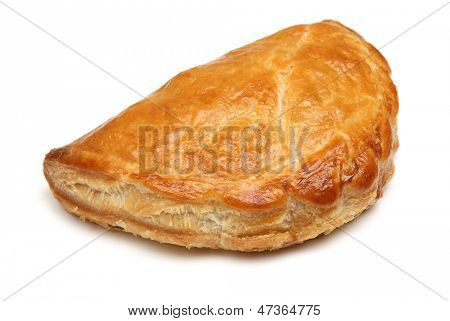 Freshly baked Cornish pastie on white background.