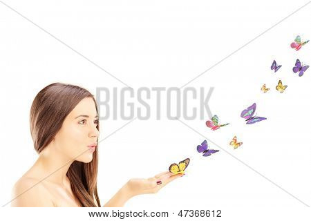 Beautiful young female with many colorful butterflies isolated on white background poster