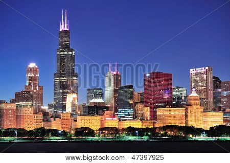 Chicago city downtown urban skyline at dusk with skyscrapers over Lake Michigan with clear blue sky. poster