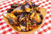 Plate of steamed mussels with tomato and white wine sauce marinara sauce poster