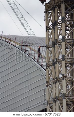 Edit: A Worker Walks Down The New Containment Shelter At Chernobyl's Nuclear Power Plant, Reactor #4