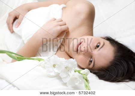 Woman on bed with flowers