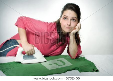 Woman bored ironing