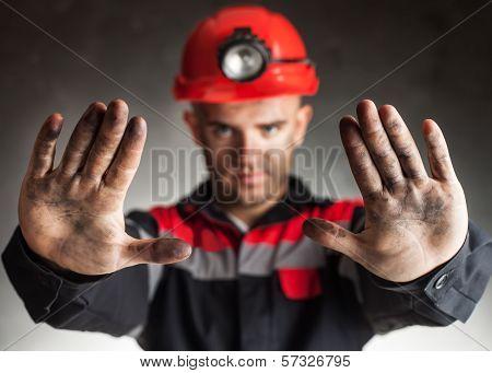 Coal Miner Making Stop Gesture