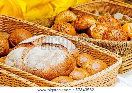 Wicker Basket Full Of Bread And Rolls