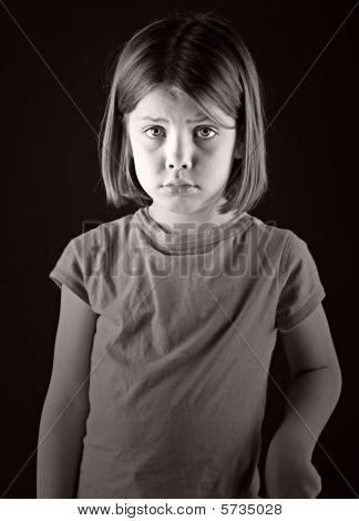 Powerful Shot Of A Sad Looking Blonde Child