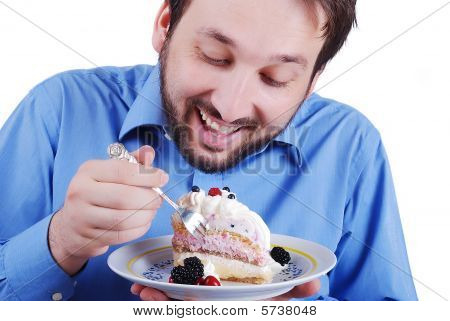 Young Man Eating Colorful Cake, Isolated
