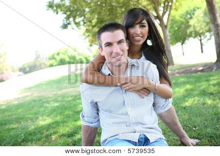 Sweet Attractive Couple In Park