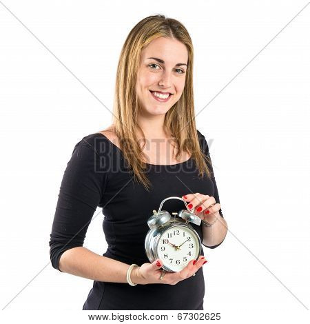 Happy Blondr Girl Holding A Clock Over White Background