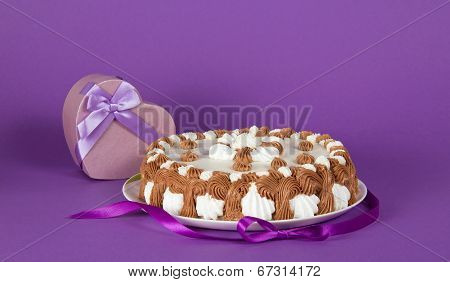 Gateau on dish decorated with tape and souvenir