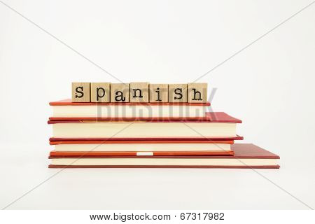 spanish word on wood stamps stack on books language and academic concept poster