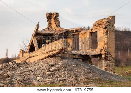 The ruins of the destroyed building in the Makeevka Donetsk region poster