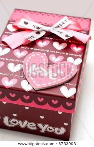 Beautiful hand-made Red Gift Box In White Background poster