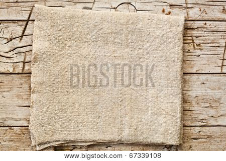 natural cotton napkin on old wooden table
