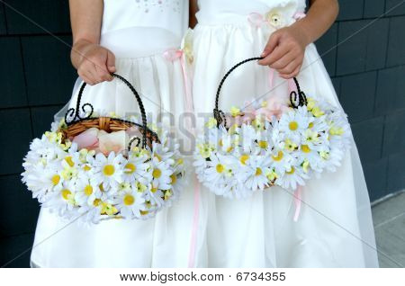 Two Flower Girls Holding Daisy Baskets