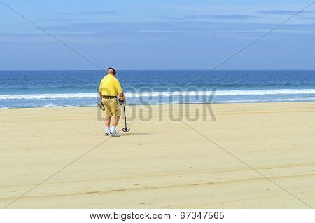 Metal Detectorist On Pacific Beach