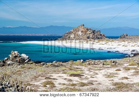 White Sand Beach And Blue Water