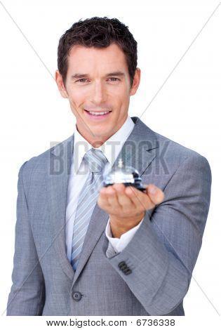 Assertive Businessman Showing A Service Bell