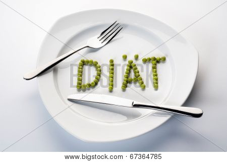 Peas Forming The Word Diet On A Plate.