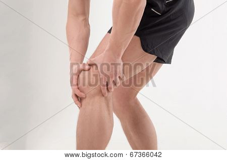 Young sportsman feeling pain