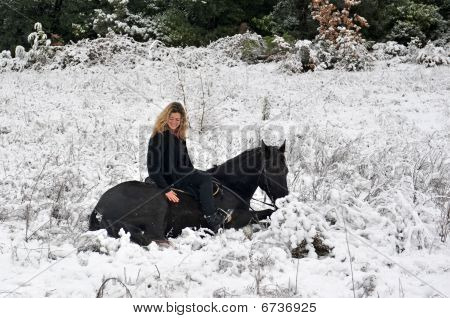 Girl And Horse In Snow