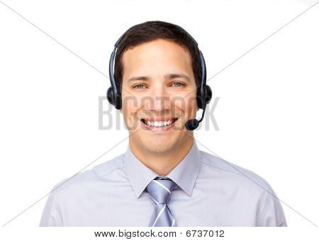 Smiling Businessman Talking On Headset