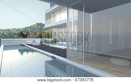 Modern luxury house with panoramic view windows overlooking a patio laid to pebbles with swimming pool and a mountain peak in the background