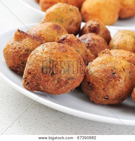closeup of a plate with bunuelos de bacalao, spanish cod fritters