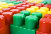 red, yellow, green toys blocks on background poster