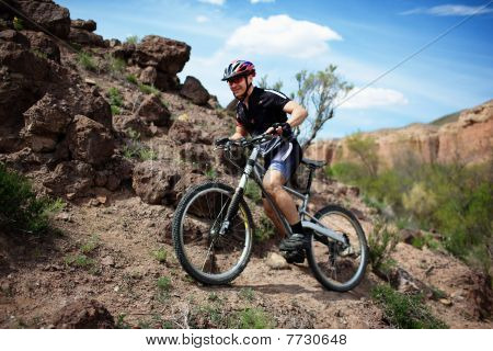 Mountain Biker In Wild Desert