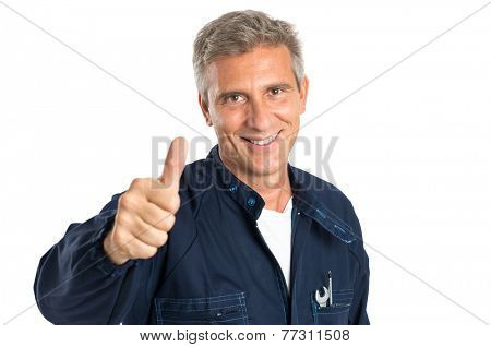 Portrait Of Confident Mature Mechanic Gesturing Thumbs Up Sign Isolated On White Backgriund