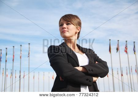 business woman on the background of international flags