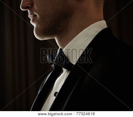Man In Elegant Black Suit With Butterfly