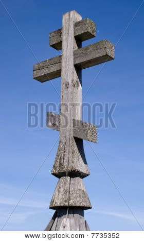 Wooden church cross on a blue sky background poster