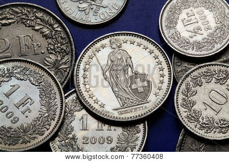 Coins of Switzerland. Standing Helvetia depicted in the Swiss one franc coins.