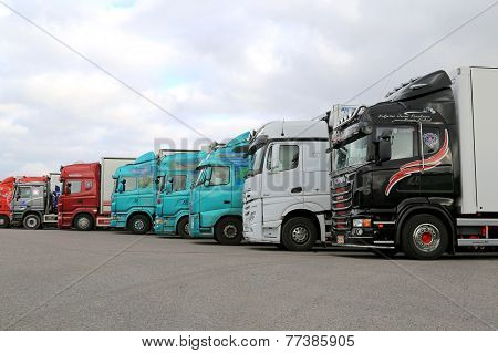 Row Of Colorful Trailer Trucks On A Yard
