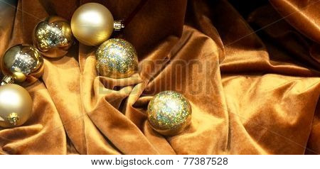 Composition of golden Christmas ornaments