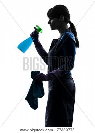 one  woman maid cleaning in silhouette studio isolated on white background