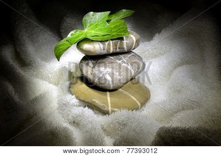 Pebbles And Ivy Leaves On Towel